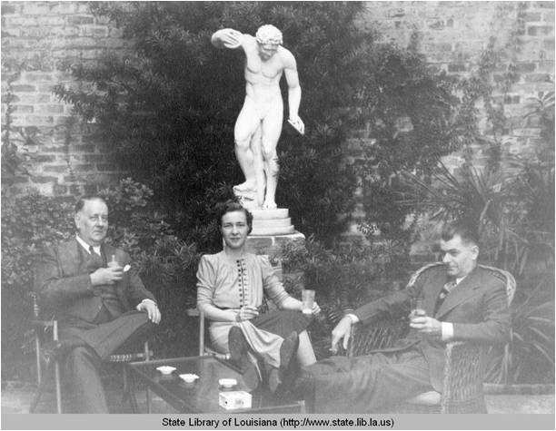 Lyle Saxon and others in his courtyard at his Madison Street house in New Orleans Louisiana in the 1940s